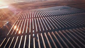 Aerial shot of solar panels - solar power plant. 4k slow motion aerial shot. Aerial desert view large industrial Solar