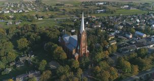 Aerial shot of St. John church of Ramygala in Lithuania. Panorama of city in early autumn. royalty free stock photo