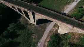 Aerial shot of the stone railway bridge stock video