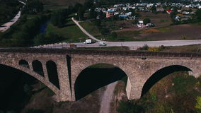 Aerial shot of the stone railway bridge stock video footage