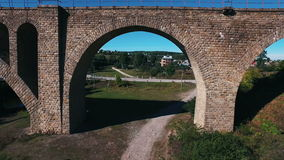 Aerial shot of the stone railway bridge stock footage