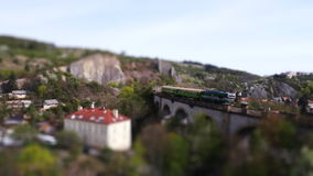 Aerial shot of the stone railway bridge with tilt shift stock video