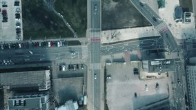 Aerial shot of street traffic and road intersections, top view. 4K video stock video