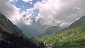 Aerial shot of summer mountain valley and clouds. Kyrgyzstan mountains. Aerial video of summer mountain valley and clouds. Kyrgyzstan mountains stock video footage