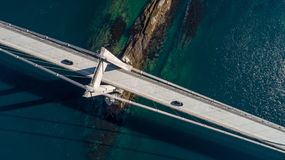 Aerial shot of a suspension bridge with 2 cars crossing it, part of route E6, over Erfjord close to Narvik Stock Photography