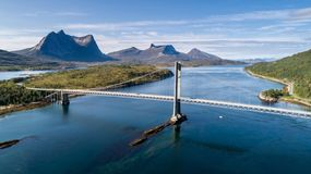 Aerial shot of a suspension bridge over Efjord with mountain Stortinden in the background Royalty Free Stock Images