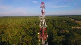 Aerial shot of telecommunication tower of cellular 5g 4g mobile signals to the consumers and smartphones.