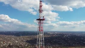 Aerial shot of telecommunication tower. Telecom tower, antennas and satellite transmits signals.