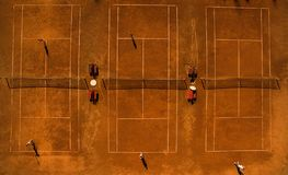Aerial shot of a tennis courts with players Stock Images