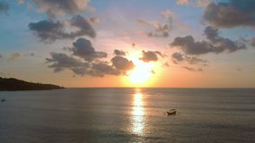 Aerial shot of three fisherman`s boat in a sea at sunset time.  stock video footage