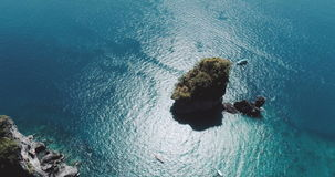Aerial shot top view video of Camel Rock in Nui Bay at Phi Phi Don. Thailand stock video footage