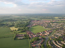 Aerial shot of town in countryside with fields. Early morning aerial shot of a town in the countryside Stock Images