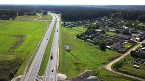 Aerial shot. Traffic on the highway above the river. 4K footage from drone stock video
