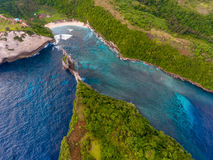 Aerial shot of the tropical coast of the island of Nusa Penida royalty free stock image