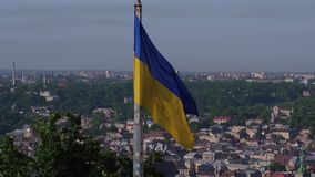 Aerial Shot Ukrainian Flag Flying on Top of the Beautiful Panorama of the City Lviv. Aerial Shot Ukrainian National Flag Flying on Top of the Beautiful Panorama stock video