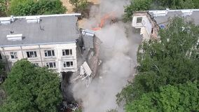 Apartment building collapse during demolition, aerial view