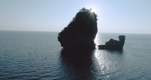 Aerial shot video of Camel Rock in Nui Bay at Phi Phi Don during sunset. Thailand stock video footage