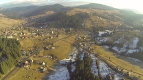 Aerial shot of village in the Carpathian mountains at spring stock video footage