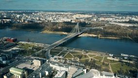 Aerial shot of Vistula river embankment and Holy Cross cable bridge in Warsaw, Poland Stock Image