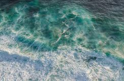 Aerial shot of waves in the ocean royalty free stock image