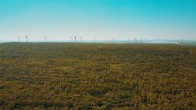 Wind turbines in autumn forest. Aerial shot of wind turbines in autumn forest. Ecologic energy production stock video