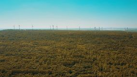 Aerial shot of wind turbines in autumn forest. Ecologic energy production concept Stock Images