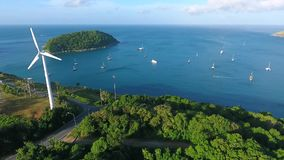 Aerial shot of windmill with the view on small paradise island. Naiharn beach, Phuket. HD.  stock footage