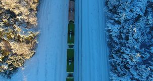 Aerial shot of winter train in forest from above. Aerial shot of winter train in forest. Aerial footage. Klaipeda, Lithuania stock video footage