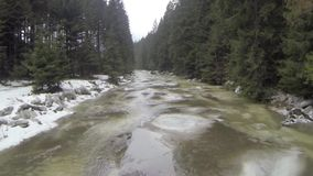 Aerial shot of winter water steam on mountains river stock footage