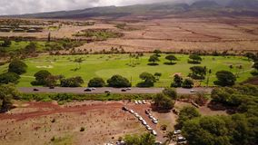 Aerial shot of wonderful scenery of volcanic terrain beautiful nature ,various cars on the background of mountains mauna. Aerial photography of volcanic stock video