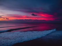 Aerial shote with colorful sunset or sunrise at ocean with waves. Aerial shote with colorful sunset or sunrise at ocean with wave Stock Photo