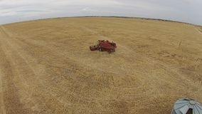 Aerial shots of harvester at work on farm stock footage