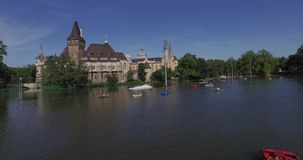 Aerial shots of Vajdahunyad Castle in Budapest, Hungary. Vajdahunyad Castle is one of the romantic castles in Budapest, located in the City Park by the boating stock video