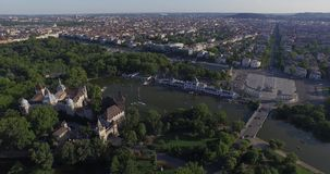 Aerial shots of Vajdahunyad Castle in Budapest, Hungary. Vajdahunyad Castle is one of the romantic castles in Budapest, located in the City Park by the boating stock footage