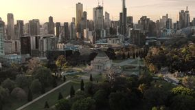 Aerial of Shrine of Remembrance and Melbourne skyline at sunset, orbit stock video