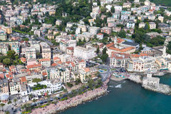 Aerial sightseen of Rapallo, Italian sea town. Aerial view of Rapallo, a small city close to Portofino in Liguria, Italy, seaside with famous castle on the see Royalty Free Stock Photos