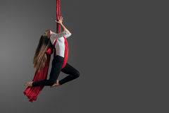 Aerial silk female performer Royalty Free Stock Photography
