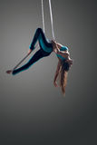 Aerial silk female performer Royalty Free Stock Photos