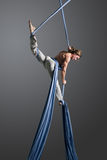 Aerial silk male performer Royalty Free Stock Image