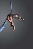 Aerial silk male performer Stock Photography