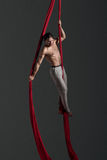 Aerial silk male performer Stock Photo