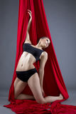 Aerial silks. Attractive dancer posing in studio Royalty Free Stock Photo