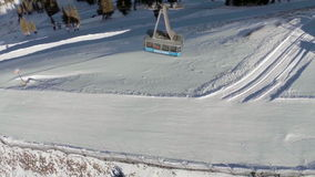 Aerial of Ski Tram Moving up Mountain stock video footage