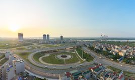 Aerial skyline view of crossroads An Duong Vuong street - Vo Chi Cong street - Au Co street to Nhat Tan bridge. Hanoi cityscape at. Twilight Stock Photography