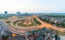 Aerial skyline view of crossroads An Duong Vuong street - Vo Chi Cong street - Au Co street to Nhat Tan bridge. Hanoi cityscape at. Twilight Royalty Free Stock Image
