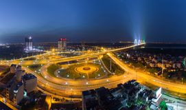 Aerial skyline view of crossroads An Duong Vuong street - Vo Chi Cong street - Au Co street to Nhat Tan bridge. Hanoi cityscape at. Twilight Stock Image