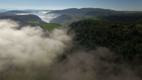 Aerial: slow flight over the clouds towards Uvac lake, Serbia.