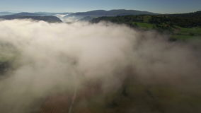 Aerial: slow flight over the road under the clouds towards Uvac lake, Serbia. stock video