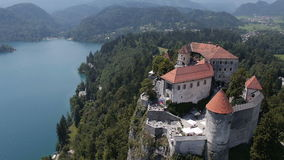 AERIAL, slow motion: Bled Castle above the lake stock video footage