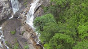 Aerial slow motion video of a beautiful waterfall in Thailand stock footage